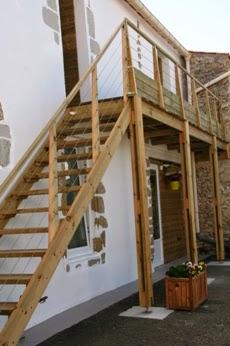 Escalier en bois avec câble en inox